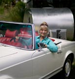 MaryJane heading out glamping in a Mercedes with trailer in tow